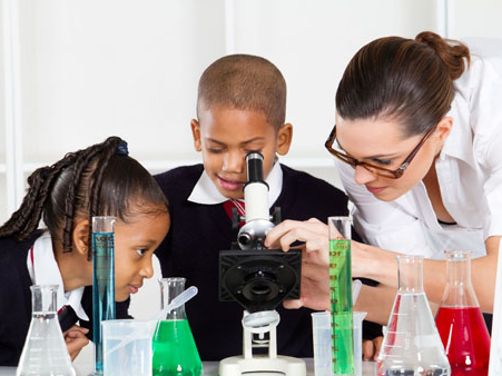 Students using microscope